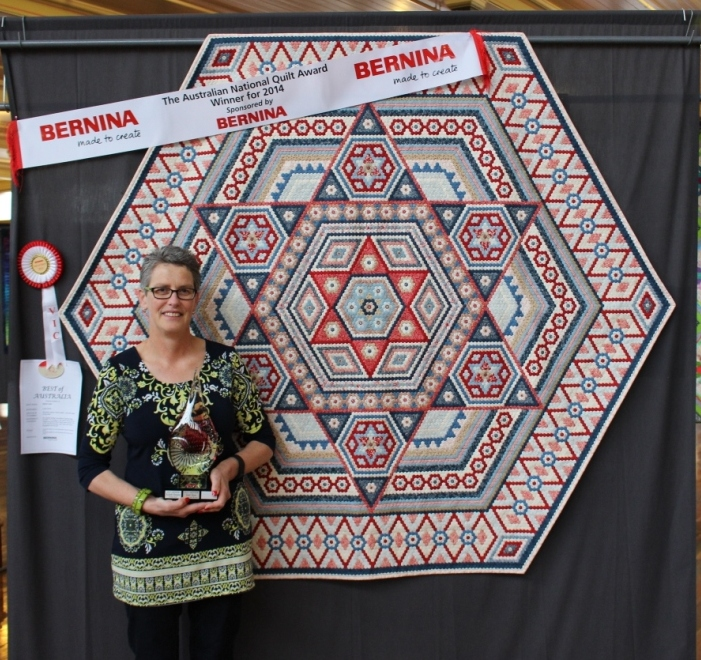 Comp photo in front of the quilt
