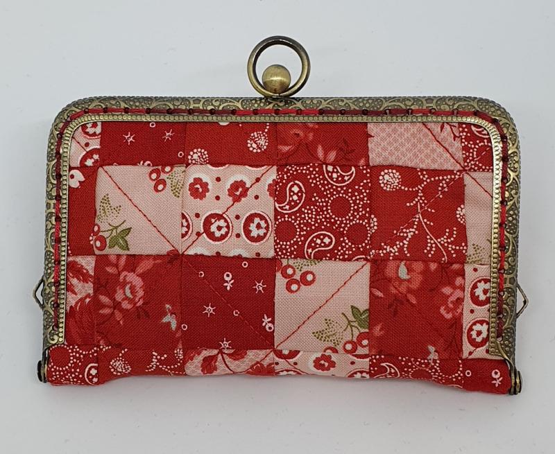 Needle purse finished closed